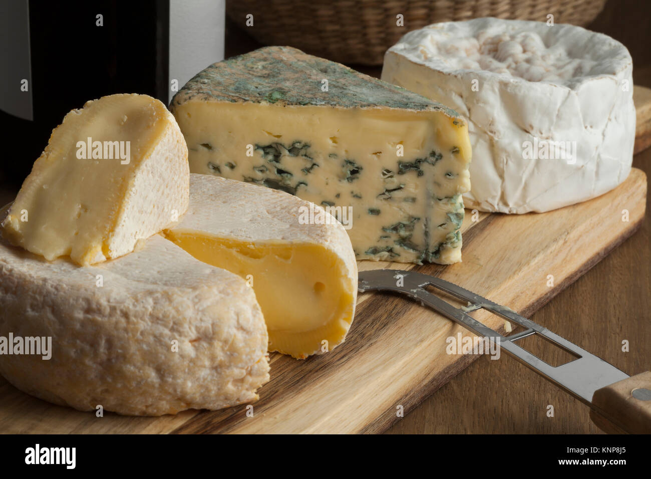 French cheese platter with variety of different cheeses for dessert - Stock Image