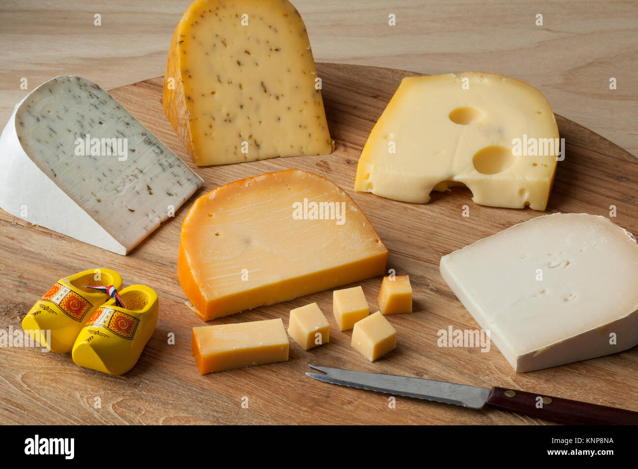 Diversity of Dutch cheese on a cutting board - Stock Image