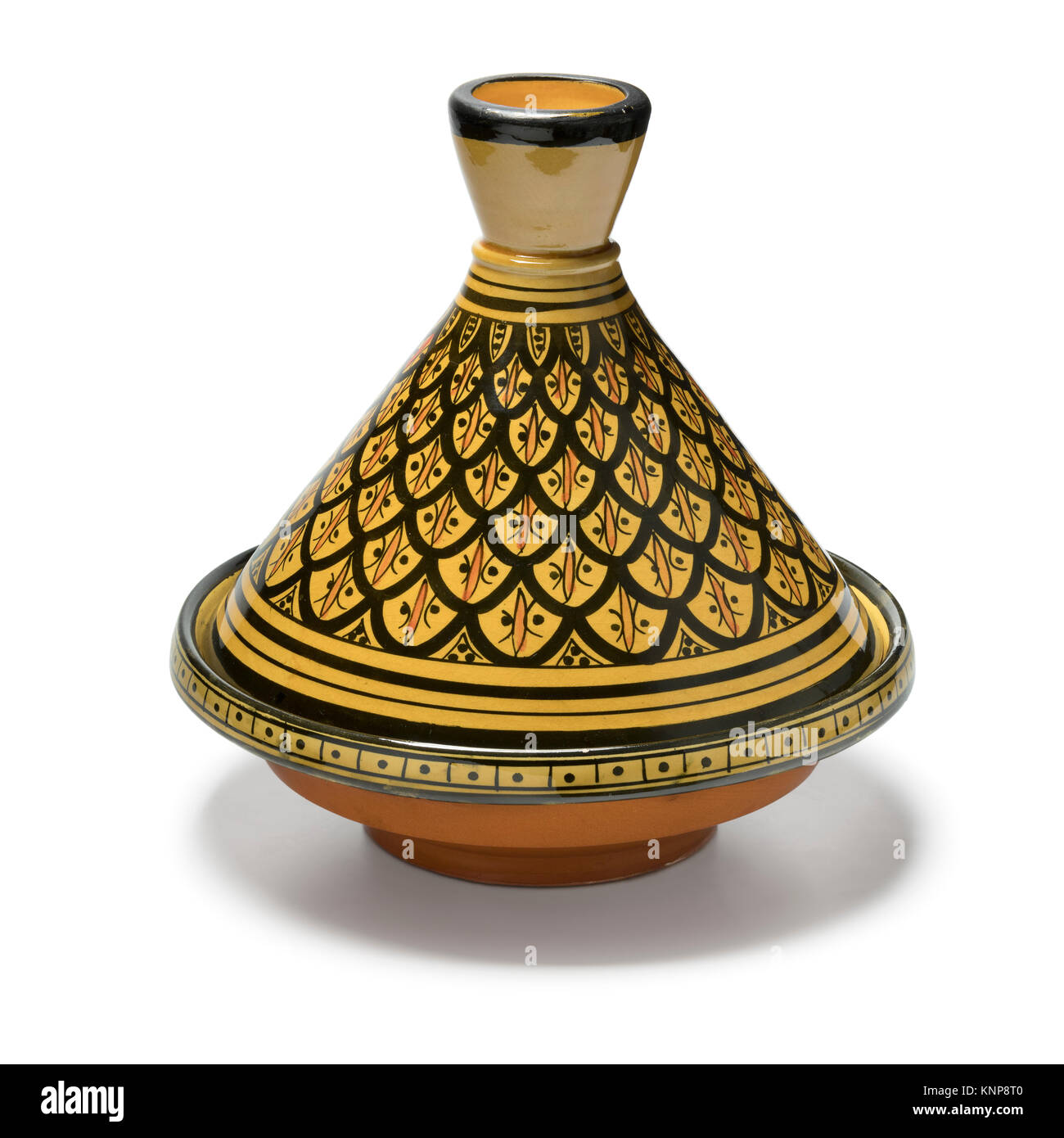 Moroccan handmade decorated tagine on white background - Stock Image