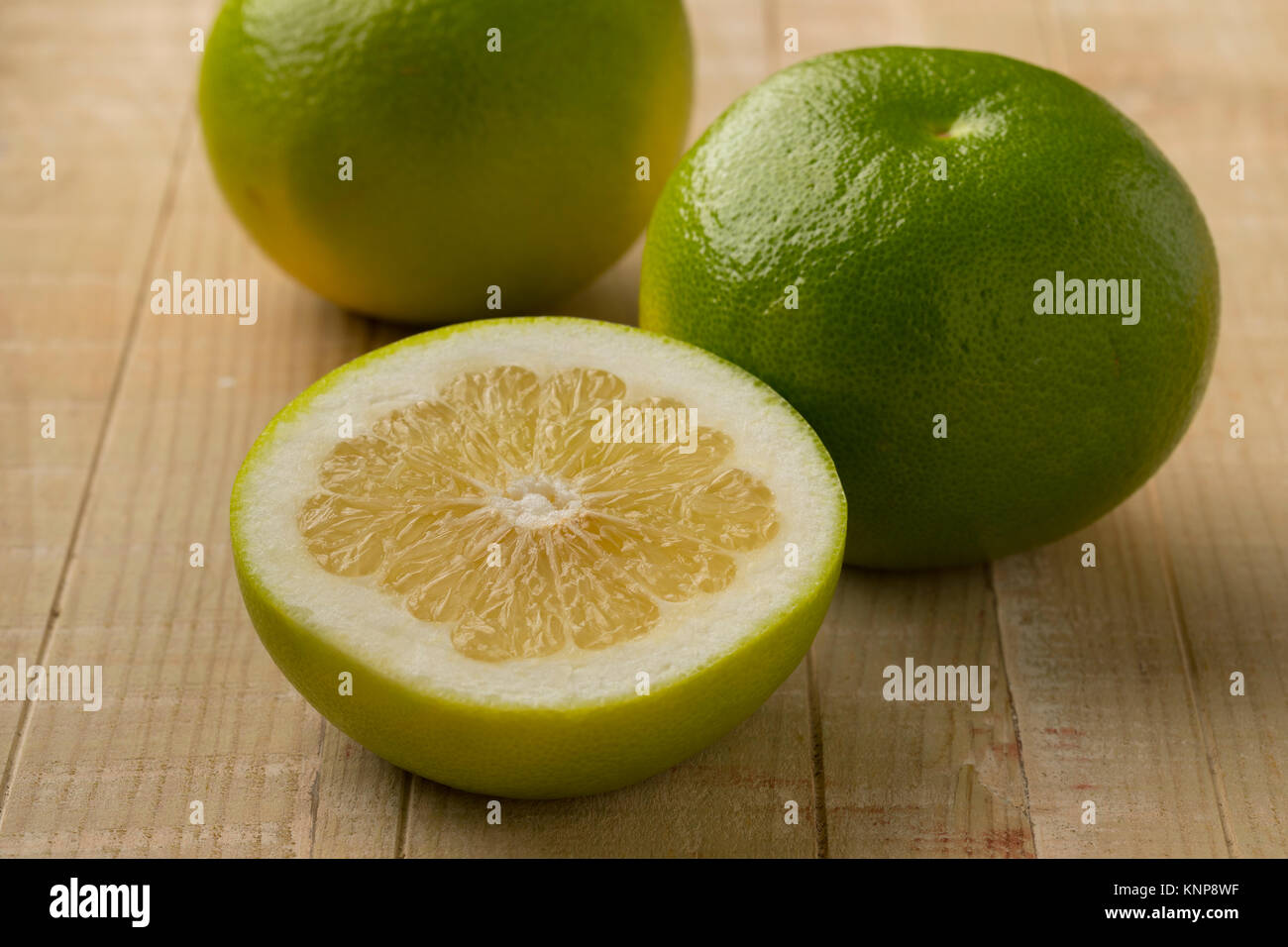 Whole and half fresh ripe oroblanco fruit - Stock Image