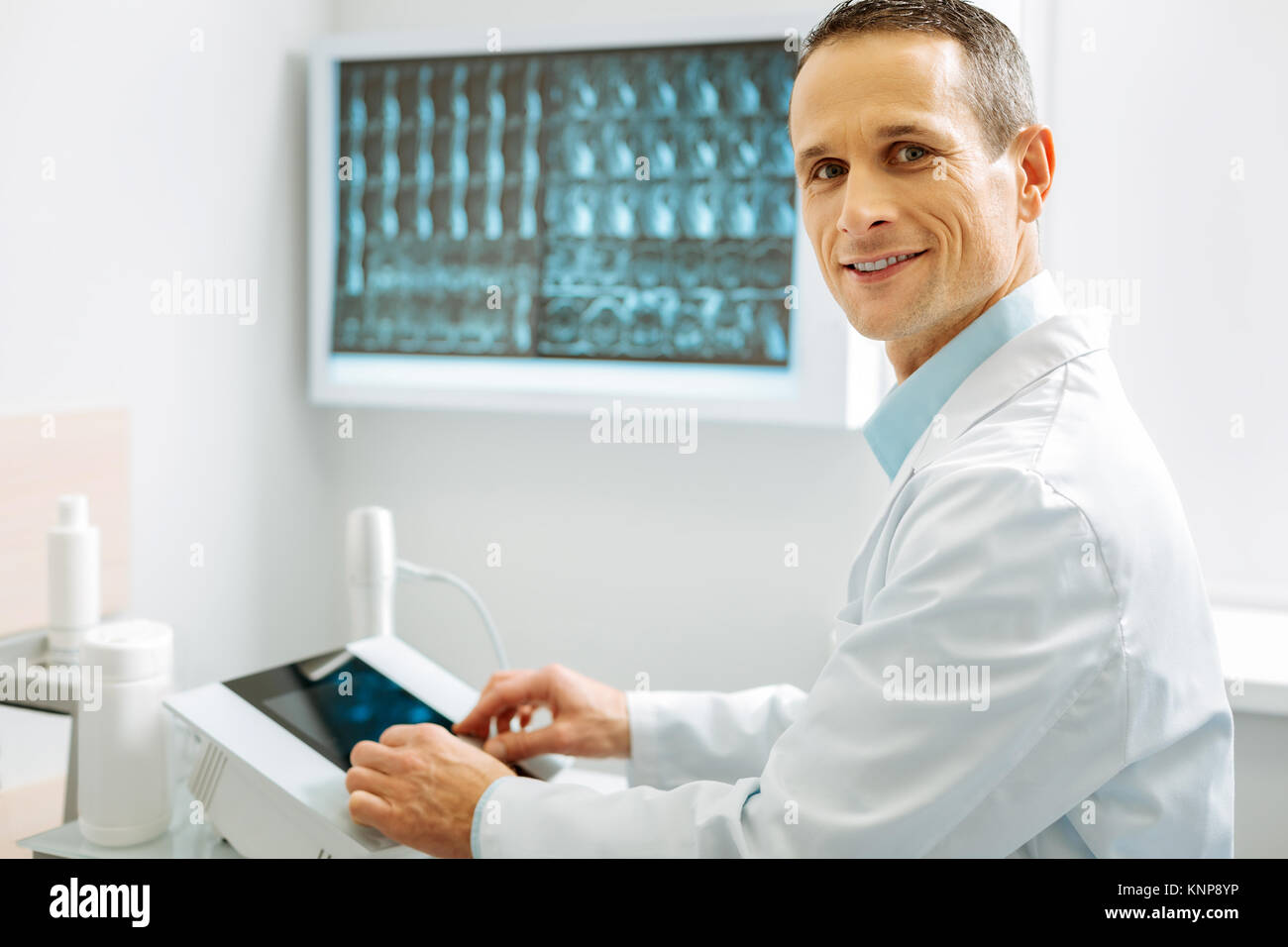 Experienced smart radiologist looking at you - Stock Image