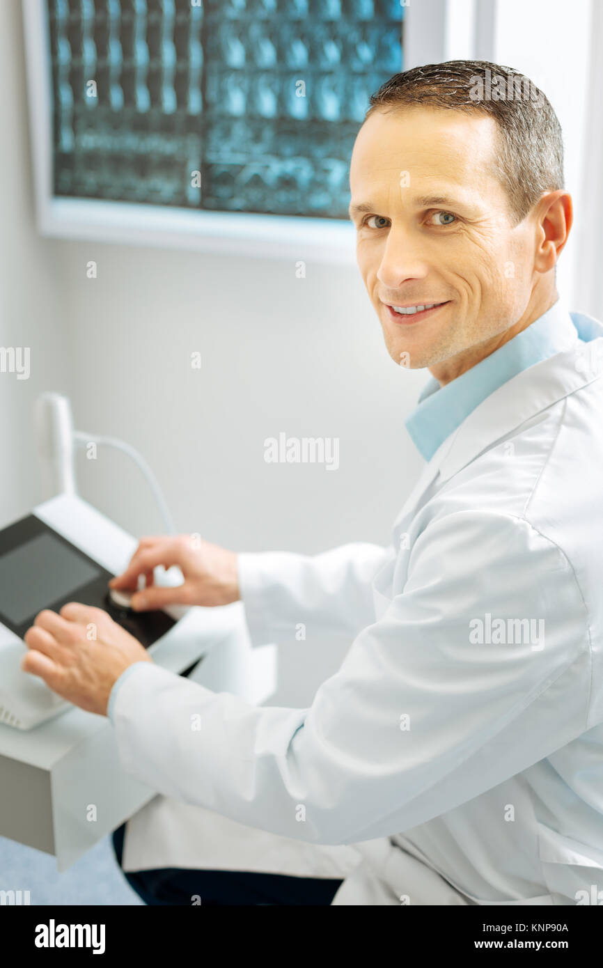 Cheerful handsome radiologist working - Stock Image
