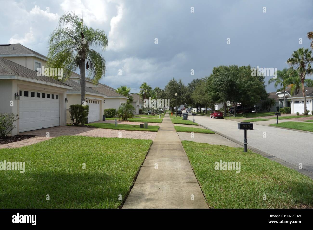 Sidewalk and manicured lawns of luxury villas in Highland Reserve Golf community, Davenport, Florida, USA Stock Photo