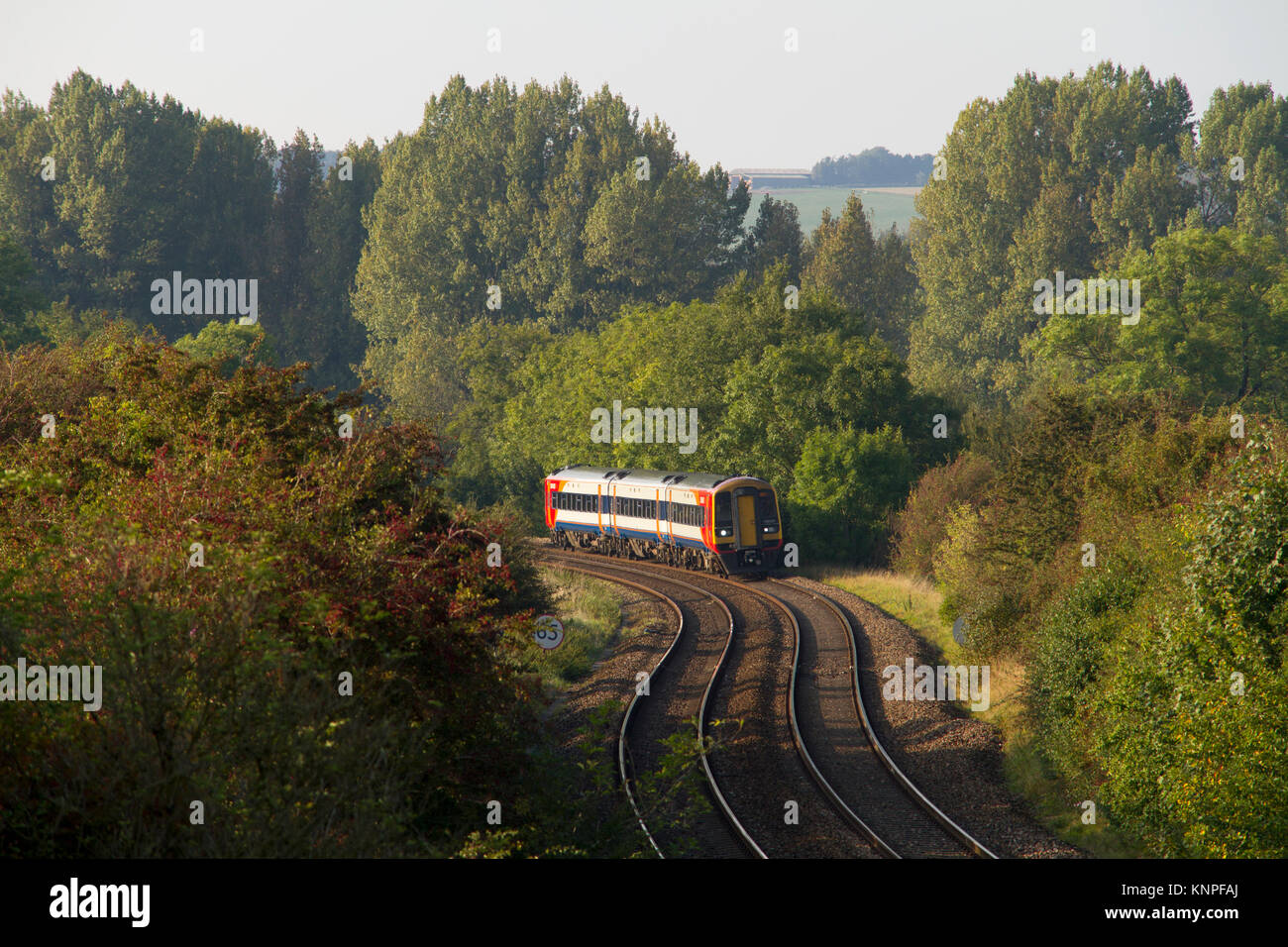 "A South West Trains class 159 ""Sprinter"" DMU passes Sherrington in the Wylye Valley with a West of England service. - Stock Image"