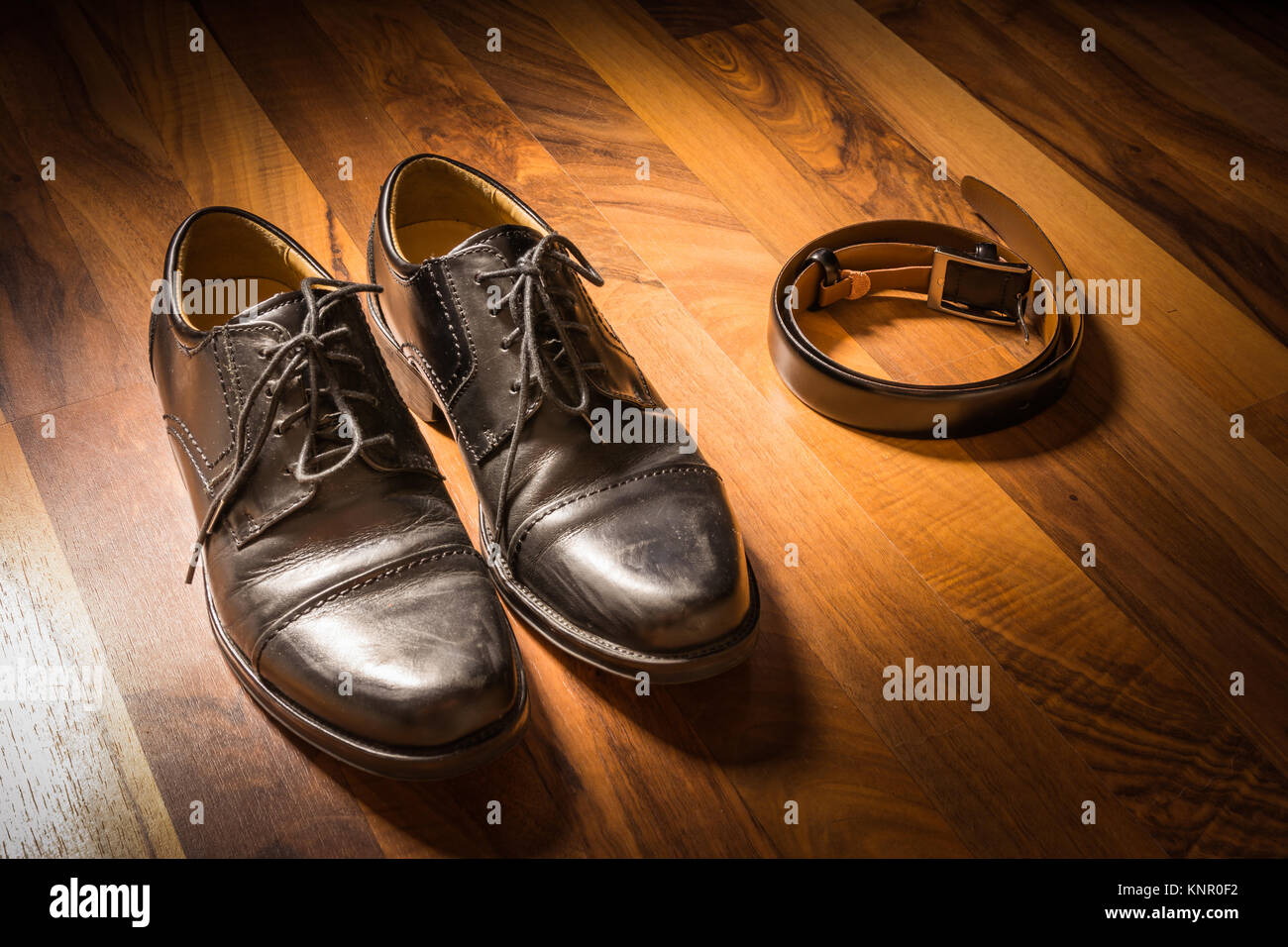 8c4db649 Stylish Black Handcrafted Dress Shoes and Leather Belt on Wooden Floor  Spotlight Sun Clothing
