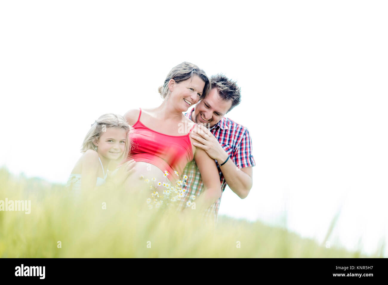 Schwangere Frau mit Mann und Tochter - pregnant woman with family Stock Photo
