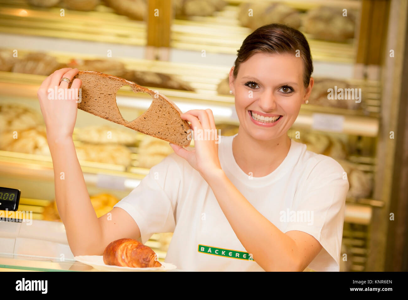 Angestellte in der Baeckerei - clerk in a bakery Stock Photo