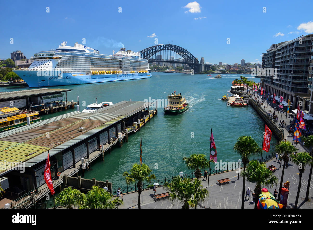 Elevated view of ferry terminal on Circular Quay, with cruise ship berthed at Overseas Passenger Terminal - Sydney, - Stock Image