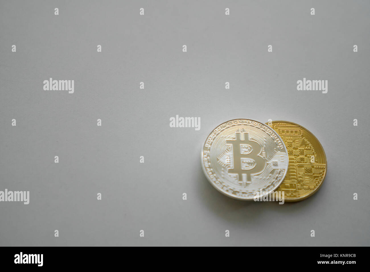 Silver and gold coins bit of a koin on a white background. BTC. Virtual currency. Crypto currency - Stock Image