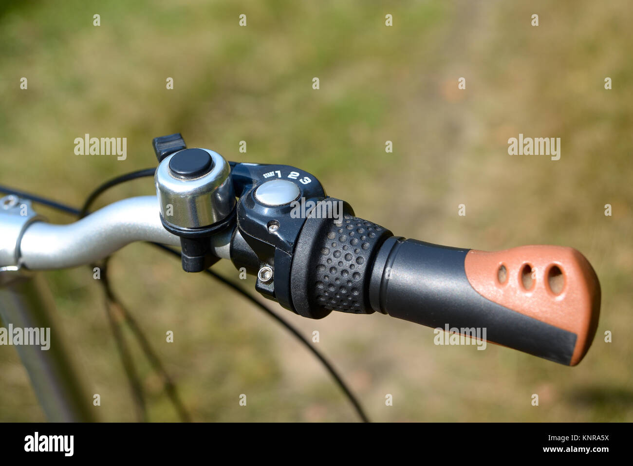 The bicycle handlebar with a gear selector and a close-up call - Stock Image