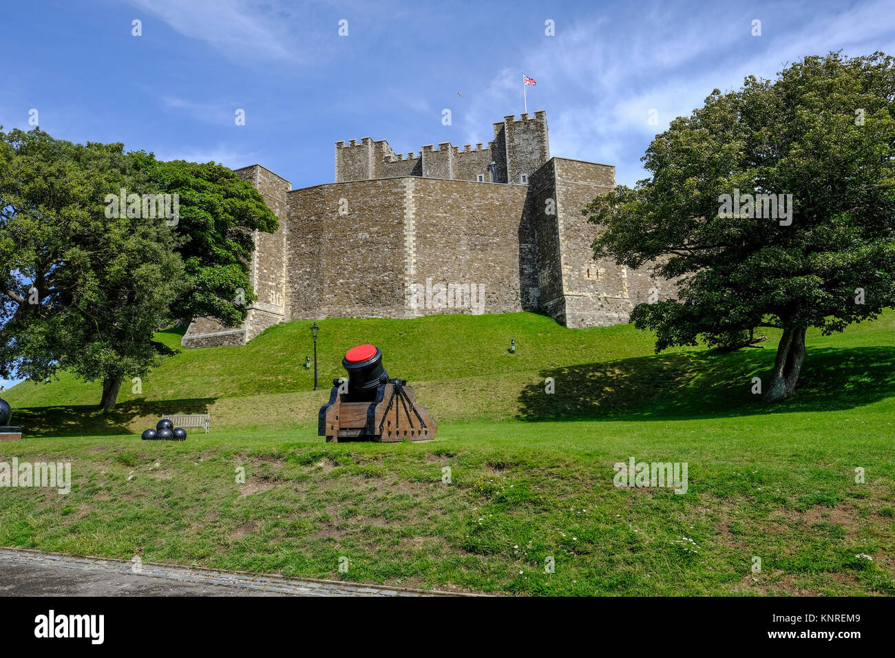 Dover Castle, Dover, Kent, UK - August 17, 2017:  Keep walls with green banks and cannon.  Bright blue sky day. Stock Photo