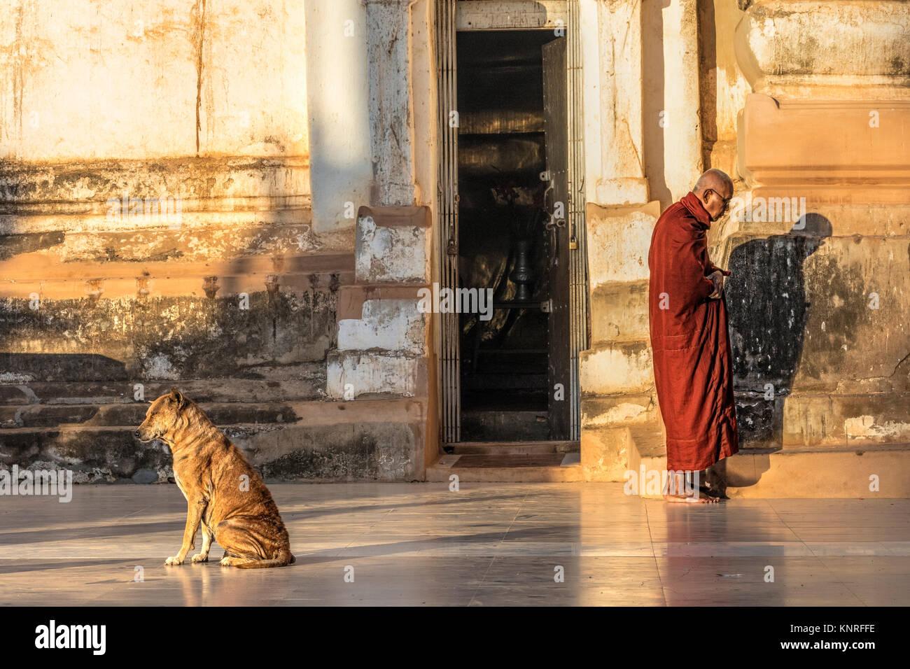 monks waiting for food in Myin Ka Bar, Bagan, Myanmar, Asia - Stock Image