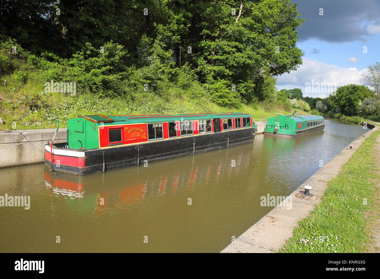 locks and narrow boats on the wey arun canal in surrey - Stock Image