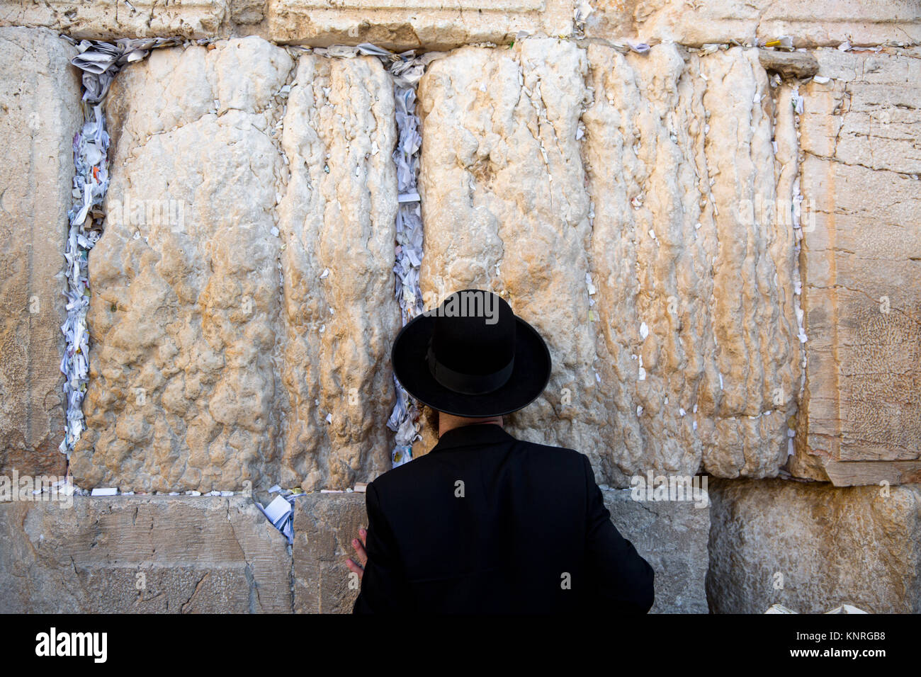 Jew praying in Jerusalem at man section of the Wailing Wall, the wall of the temple - Stock Image