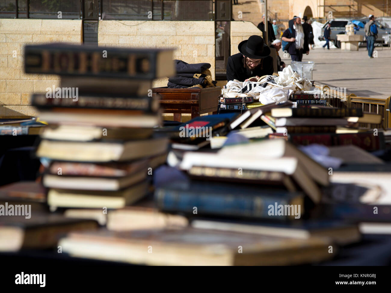 An orthodox Jew reads a torah at the Western Wall in the center of Jerusalem, Israel Stock Photo