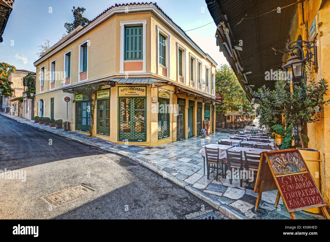 A picturesque restaurant of Plaka in Athens, Greece - Stock Image