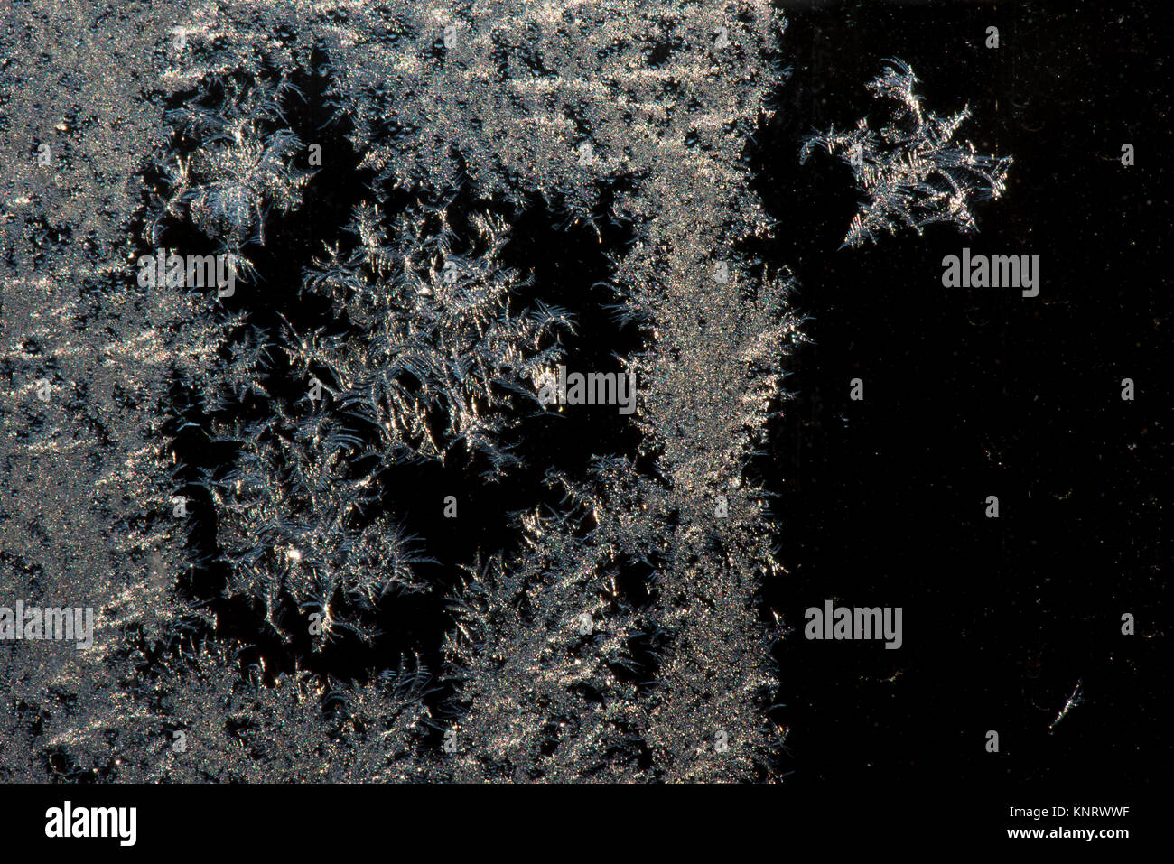Macro shot of frozen ice crystals on a window from the recent cold weather, UK - Stock Image