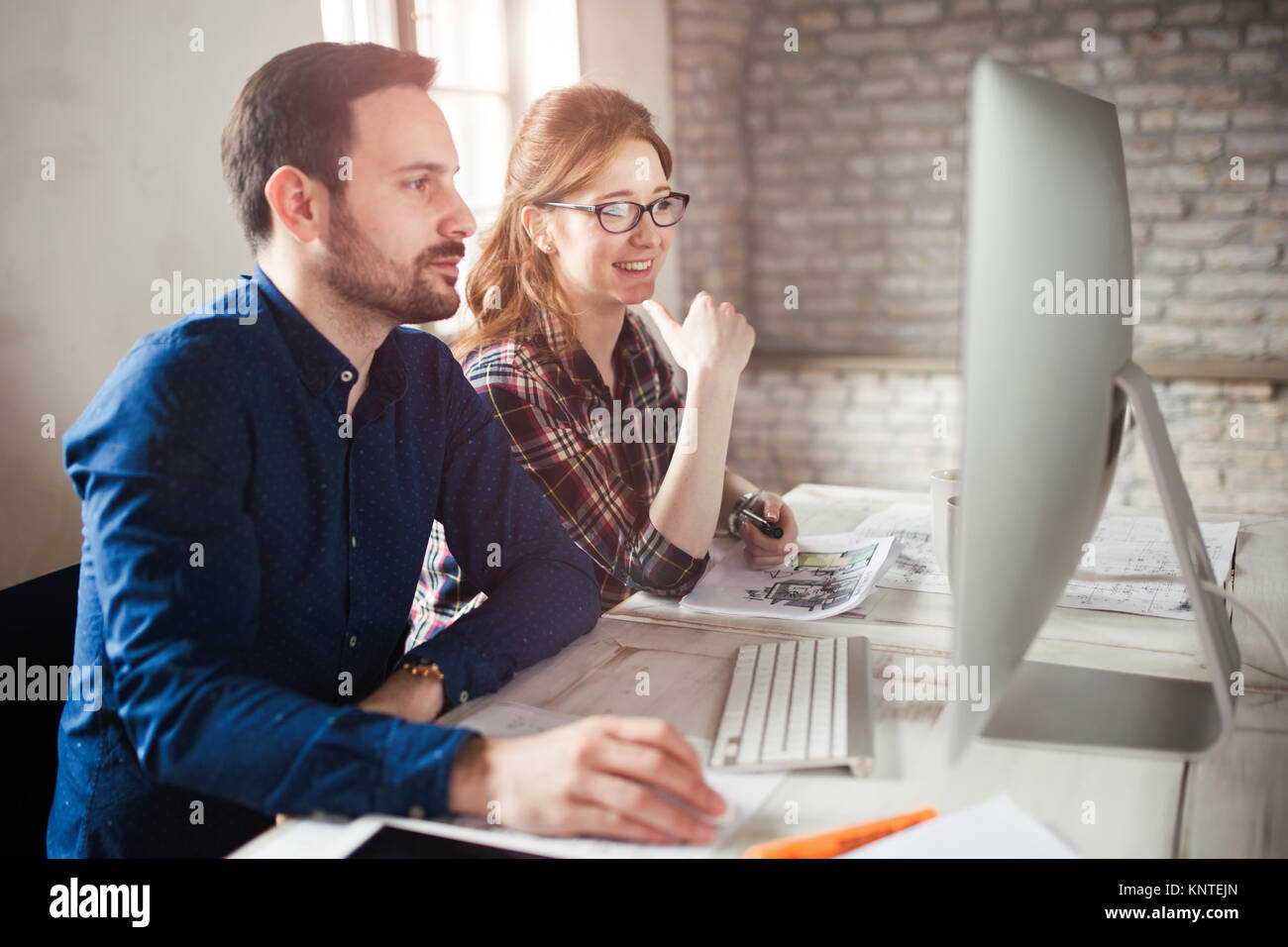 Programmers working in a software developing company office - Stock Image