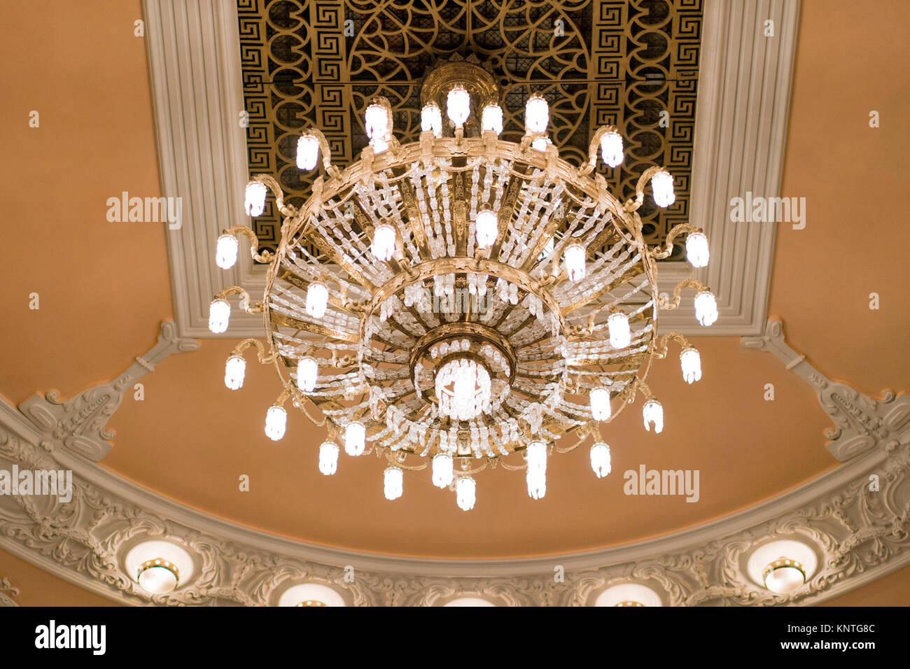 Chandelier on decoarted ceiling of a ballroom Stock Photo