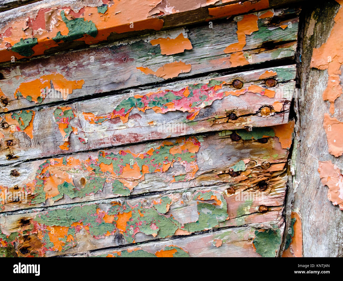 A run down and forgotten old wooden boat in a state of dereliction. - Stock Image