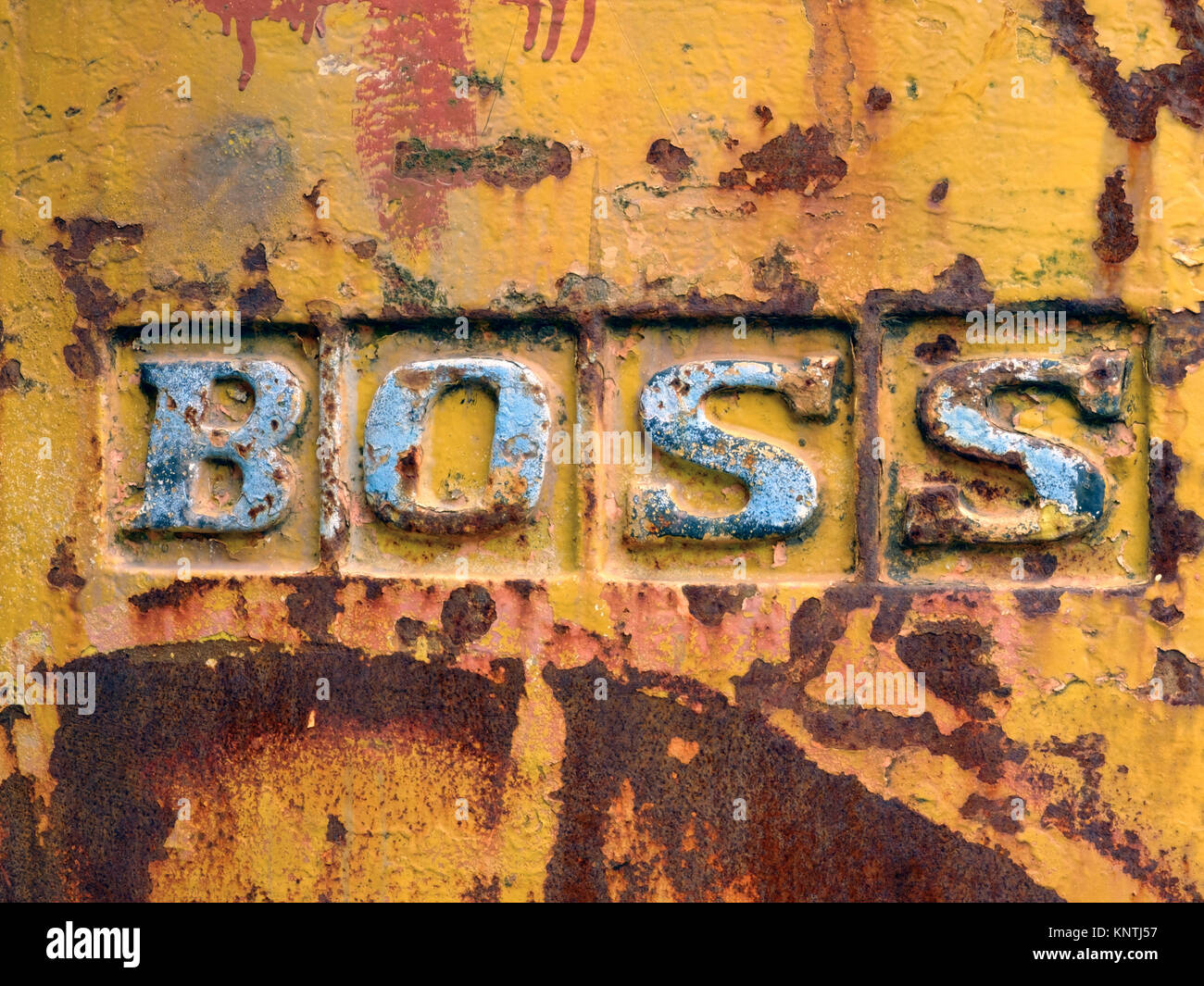 Rusty oil drum with uppercase letters. - Stock Image