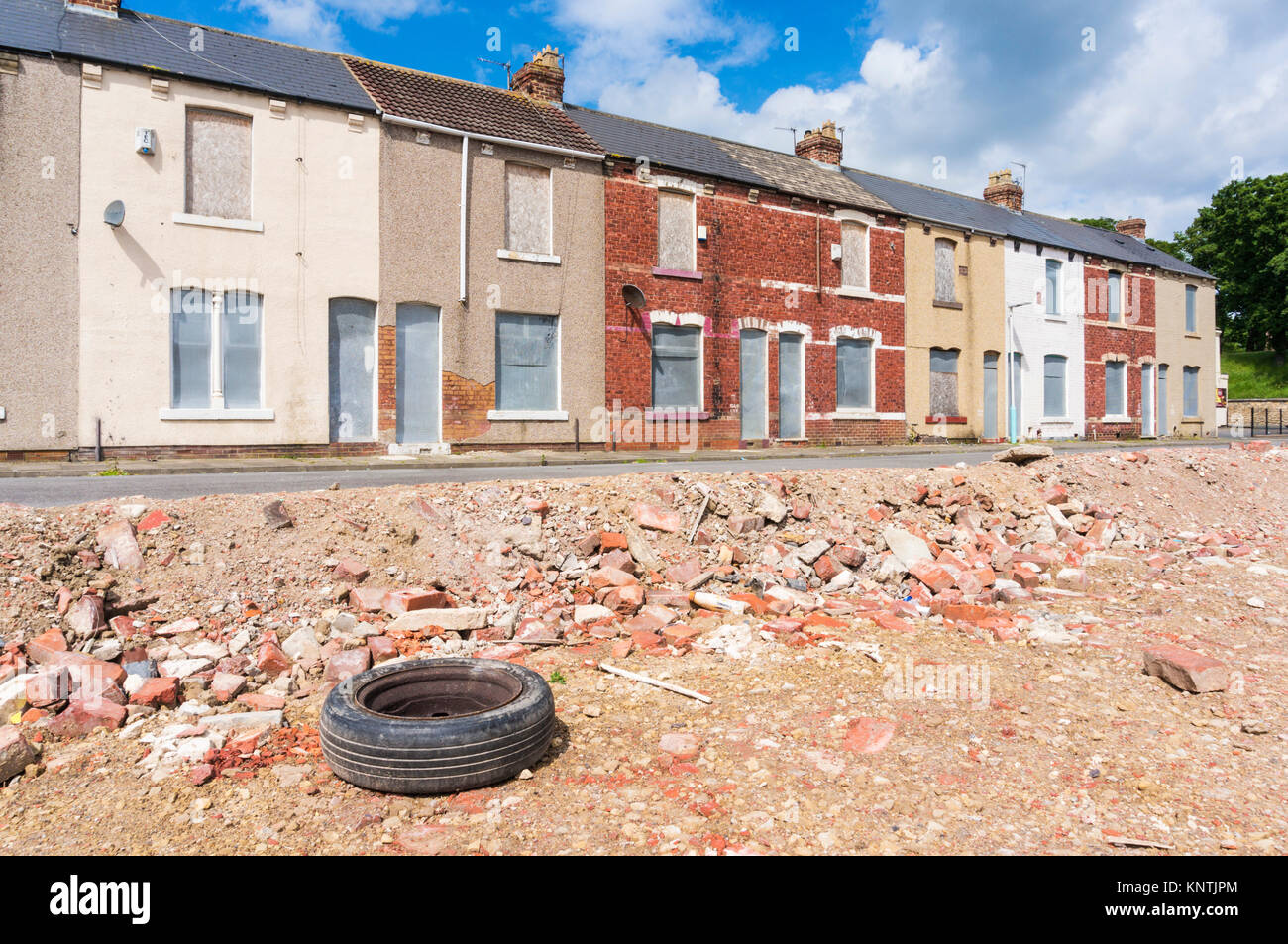 derelict terraced houses England Hartlepool england abandoned houses on building site ready for demolition or redevelopment - Stock Image