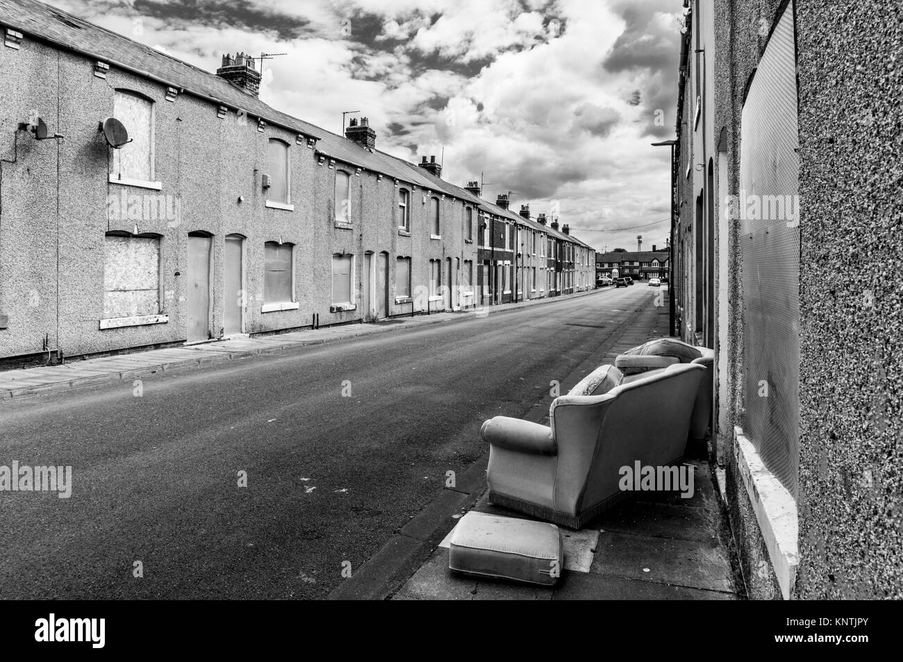 hartlepool derelict terraced houses with old sofa outside England Hartlepool england abandoned houses ready for - Stock Image