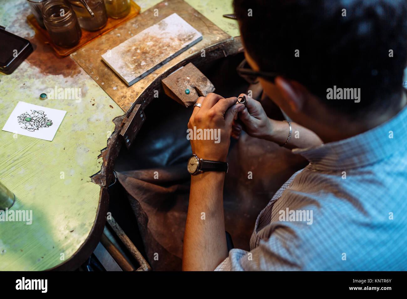 Craftsman working on workbench - Stock Image