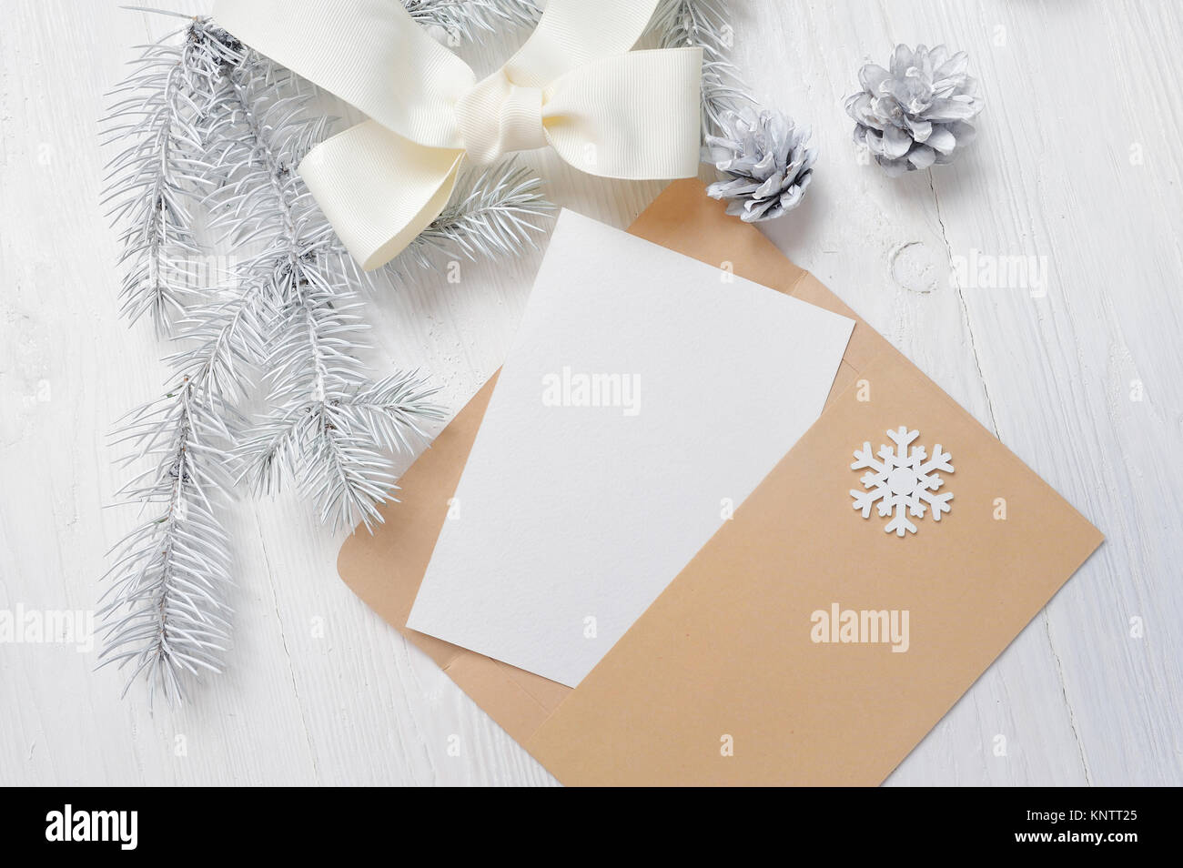 Mockup christmas greeting card letter in envelope with white tree mockup christmas greeting card letter in envelope with white tree and cone flatlay on a wooden background with place for your text m4hsunfo