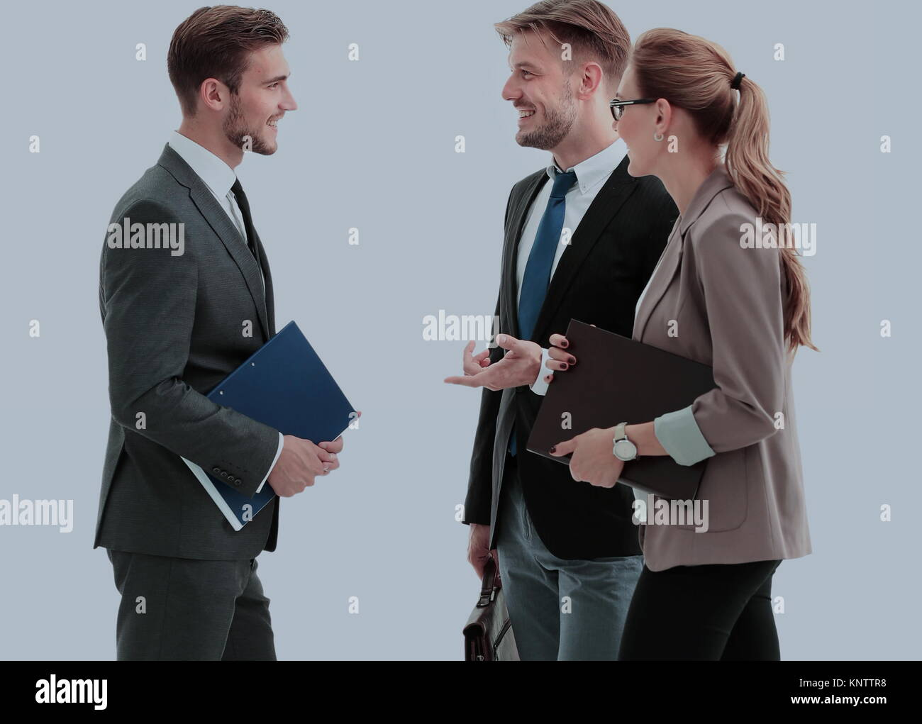 Image of business partners discussing ideas at meeting - Stock Image