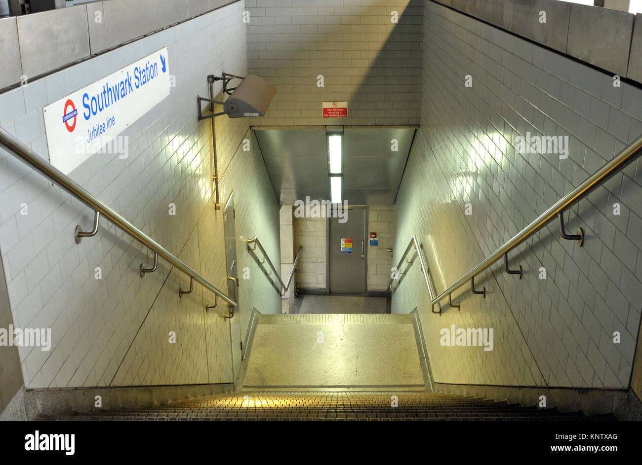 The steps or stairs down to the tube at Southwark in London from waterloo east mainline railway station. Transport - Stock Image