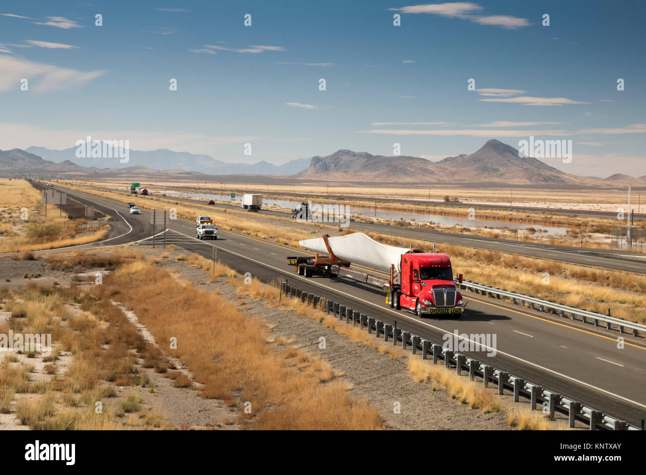Lordsburg, New Mexico - A truck carries a blade for a wind turbine on Interstate 10. - Stock Image
