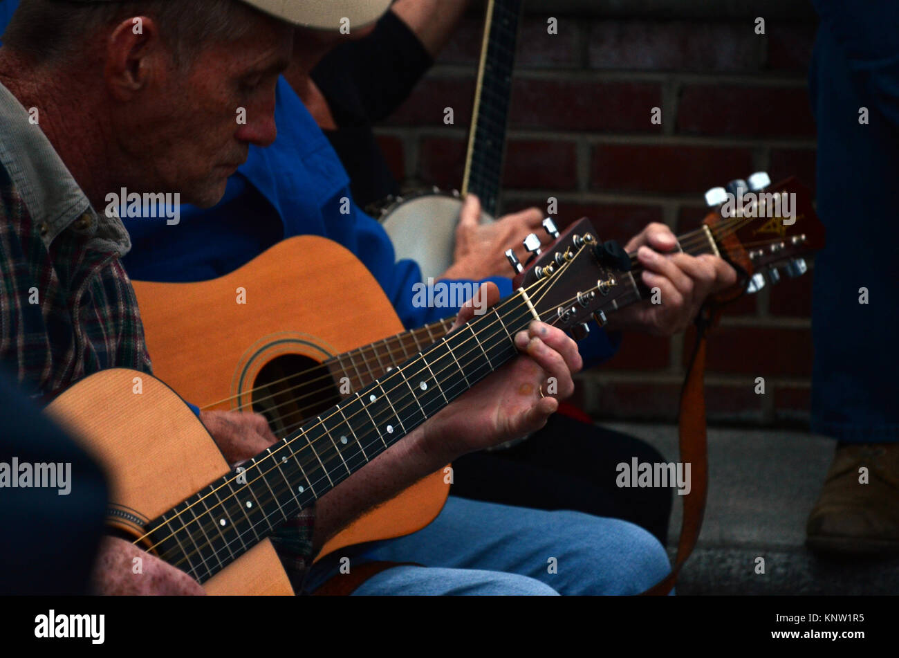 Musicians playing outside in the street at the Friday Night Jamboree at Floyd Country Store in Floyd, Virginia, - Stock Image