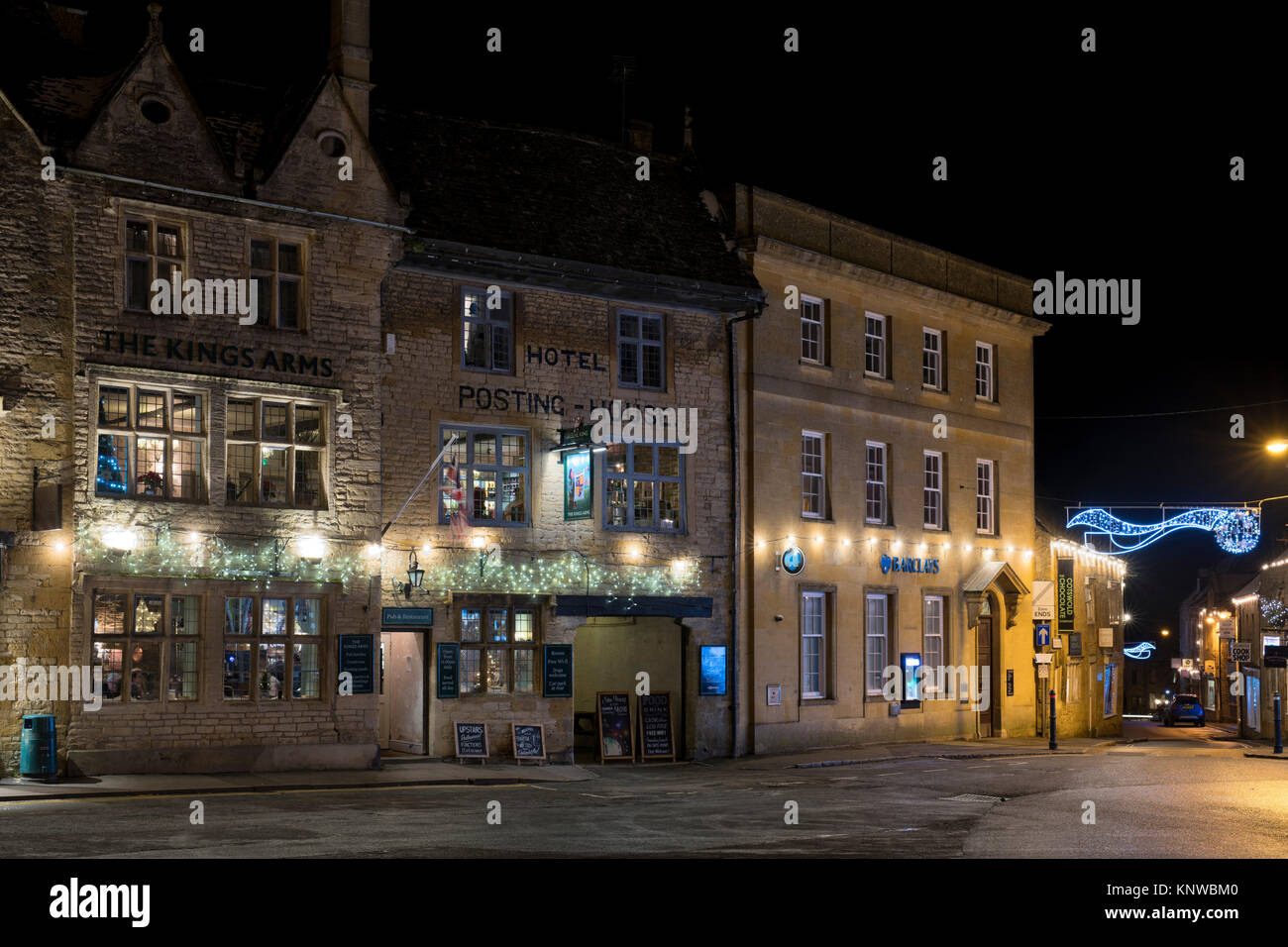 The Kings Arms and Posting house hotel with christmas decorations at night. Stow on the Wold, Cotswolds, Gloucestershire, - Stock Image