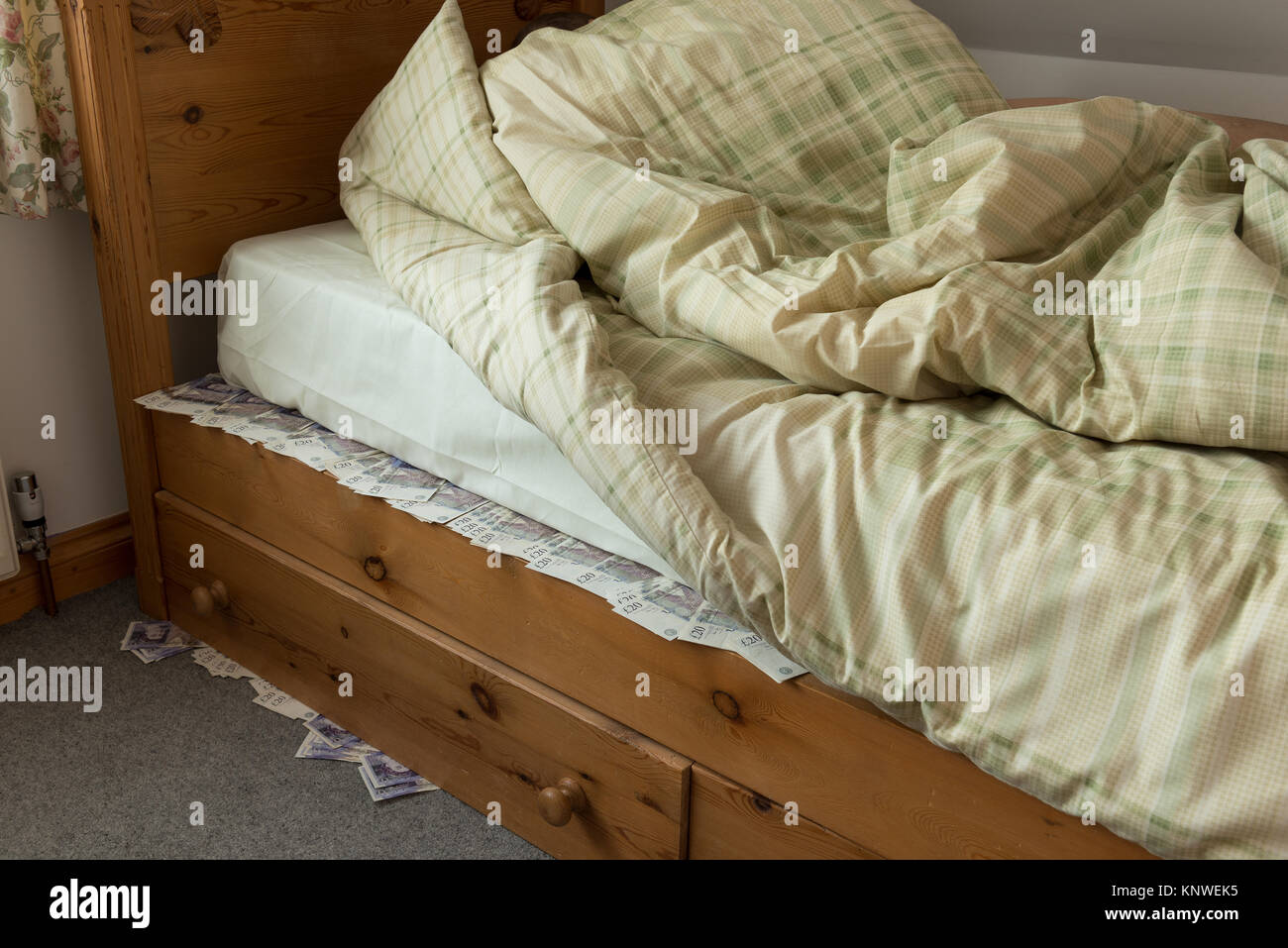Sleeping On Top Of Stashed Cash Money Banknotes Under The Bed Stock Photo Alamy