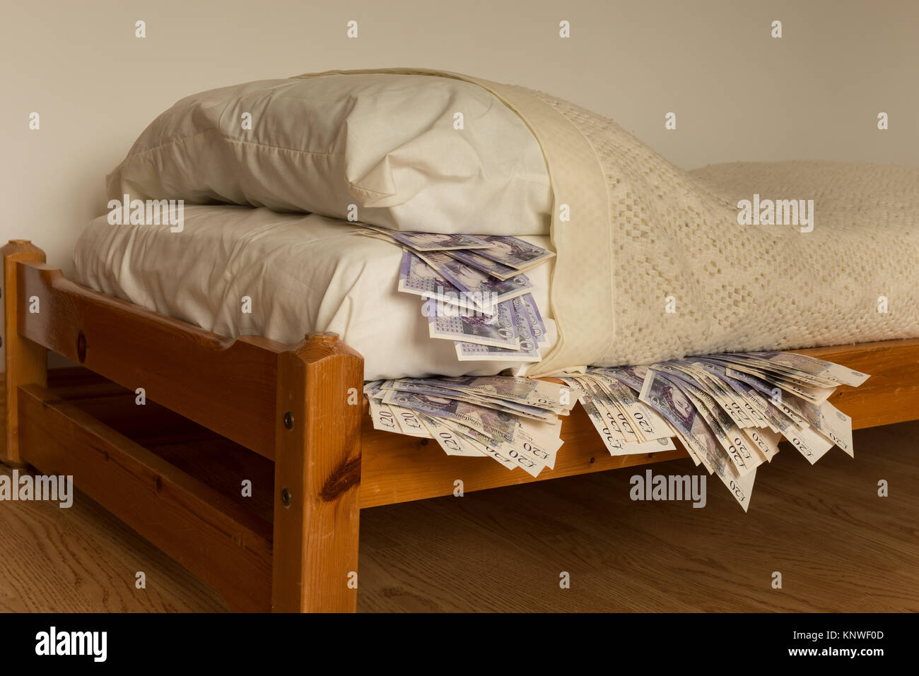 A Ready Supply Of Stashed Cash Money Banknotes Under The Bed Mattress Stock Photo Alamy