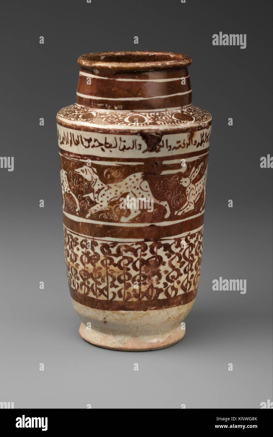 Apothecary Jar with Running Hares and a Dog. Object Name: Jar; Date: 12th century; Geography: Country of Origin Stock Photo