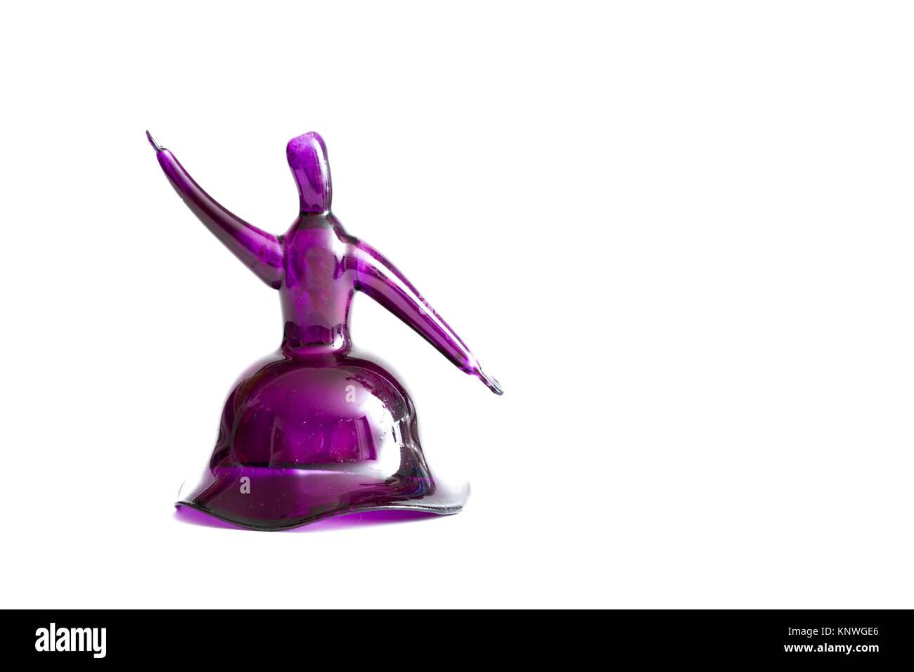 Purple handmade glass semazen figurine on white background - Stock Image