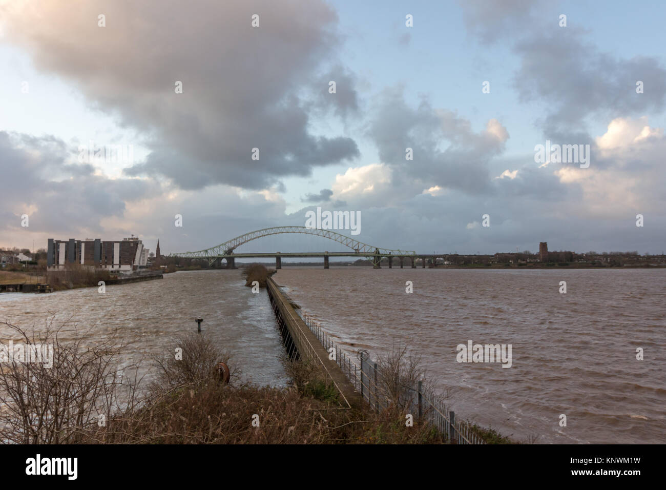 Looking out across the River Mersey at the old Runcorn Silver Jubilee Bridge and the new Mersey Gateway Bridge Stock Photo