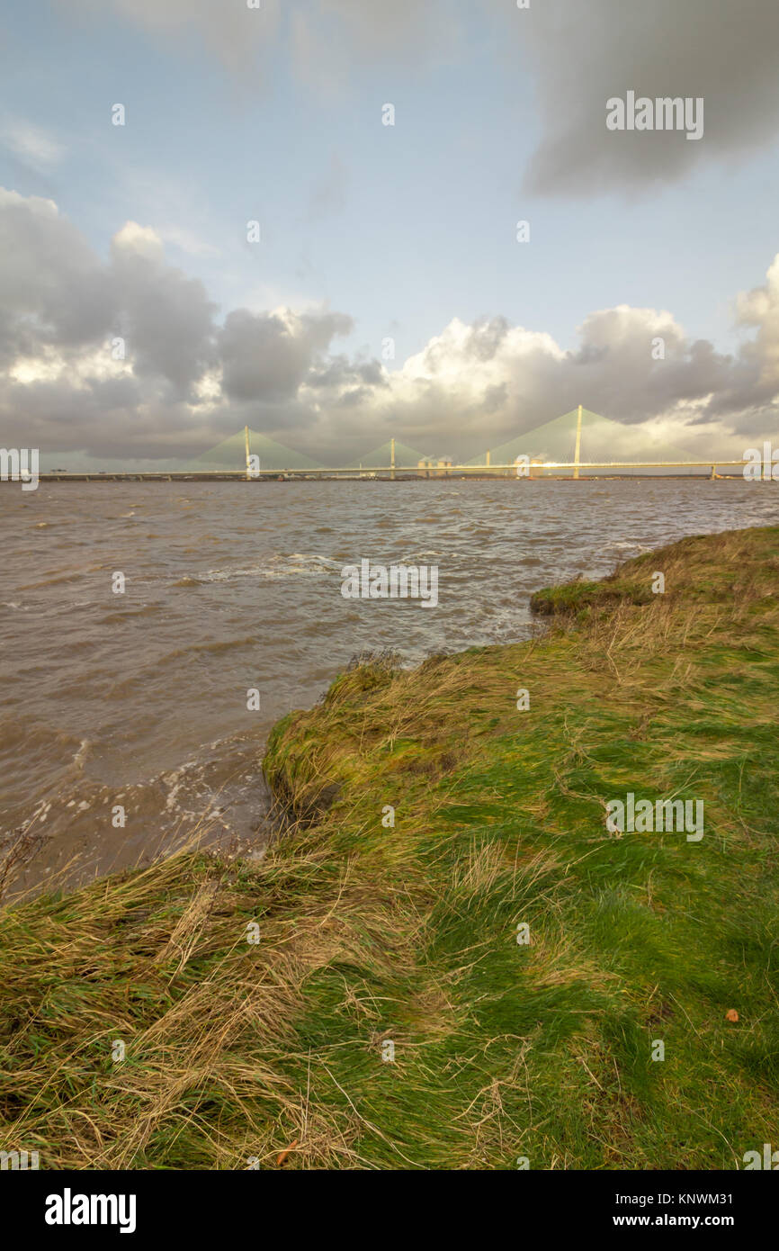Looking out across the River Mersey at the old Runcorn Silver Jubilee Bridge and the new Mersey Gateway Bridge - Stock Image