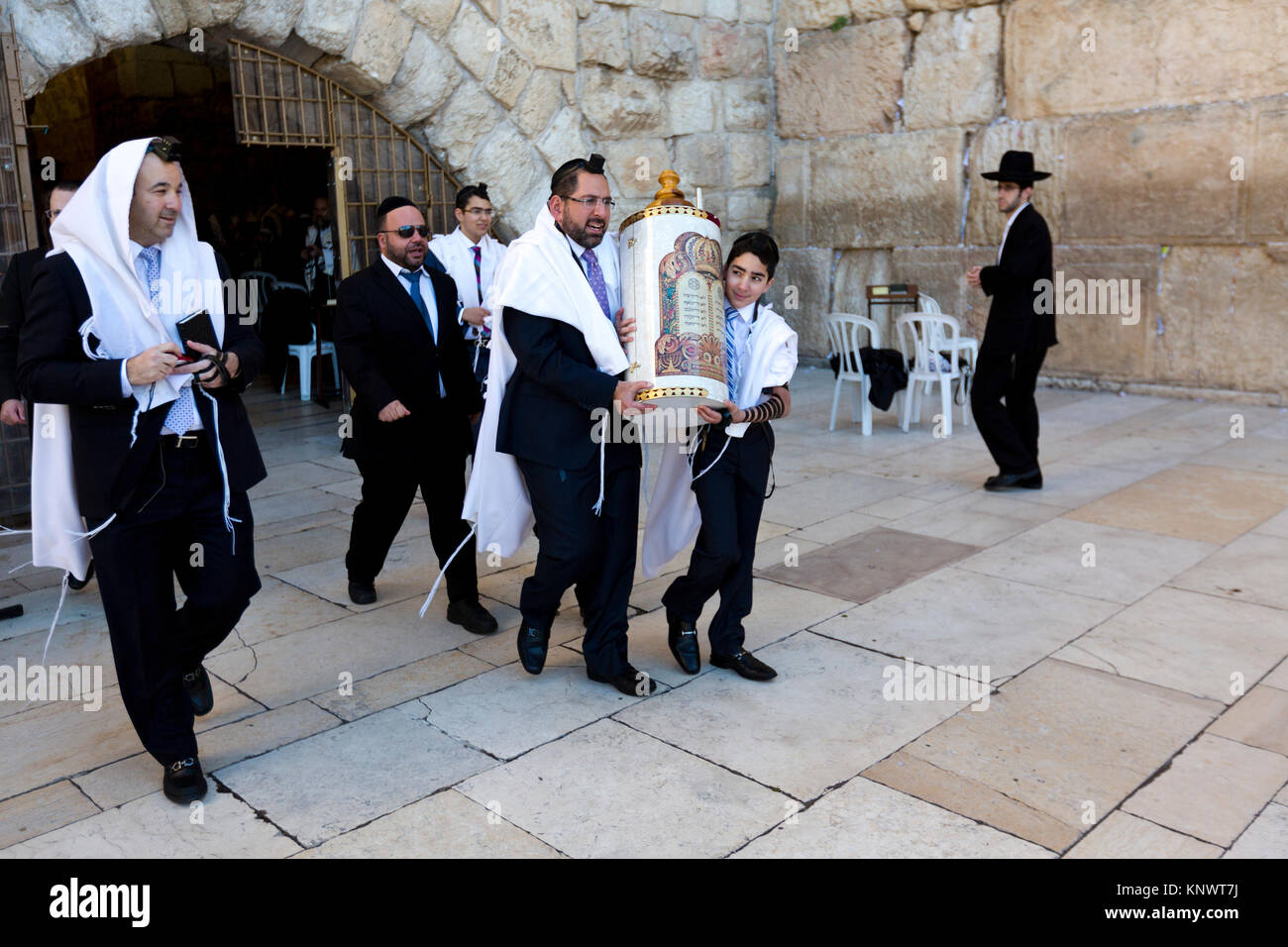 Celebrating the boy's attainment of religious adulthood or the Bar Mitzvah celebration at the Western Wall in - Stock Image