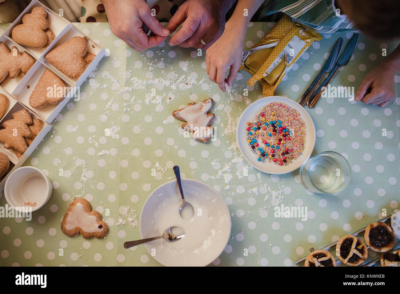 Overhead view of a father and son making christmas treats. - Stock Image