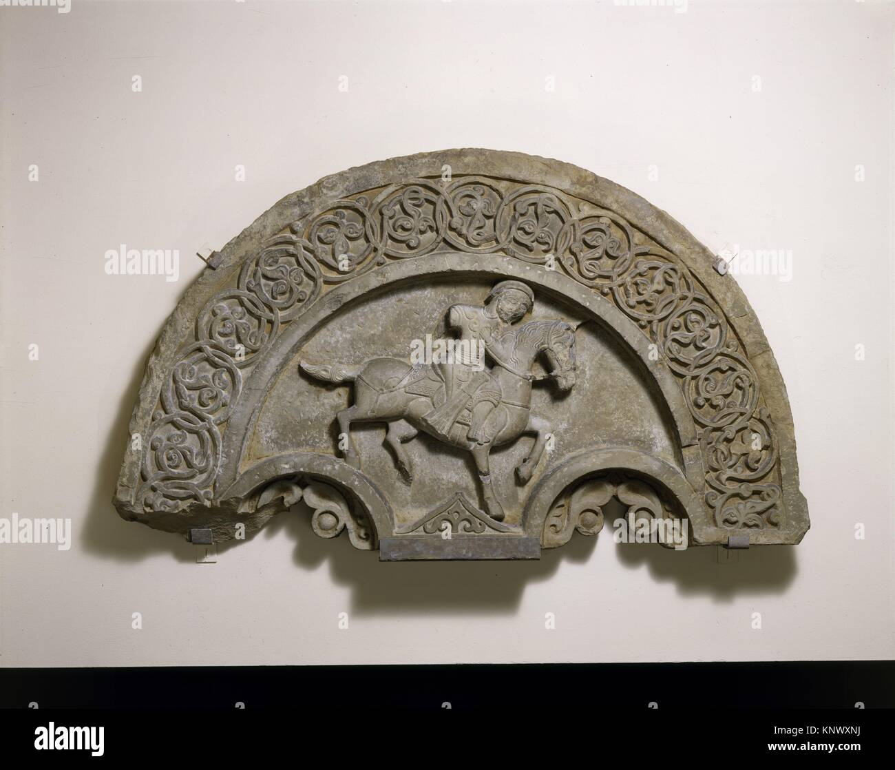 Tympanum with a Horse and Rider. Object Name: Tympanum; Date: second half 14th century; Geography: Attributed to - Stock Image