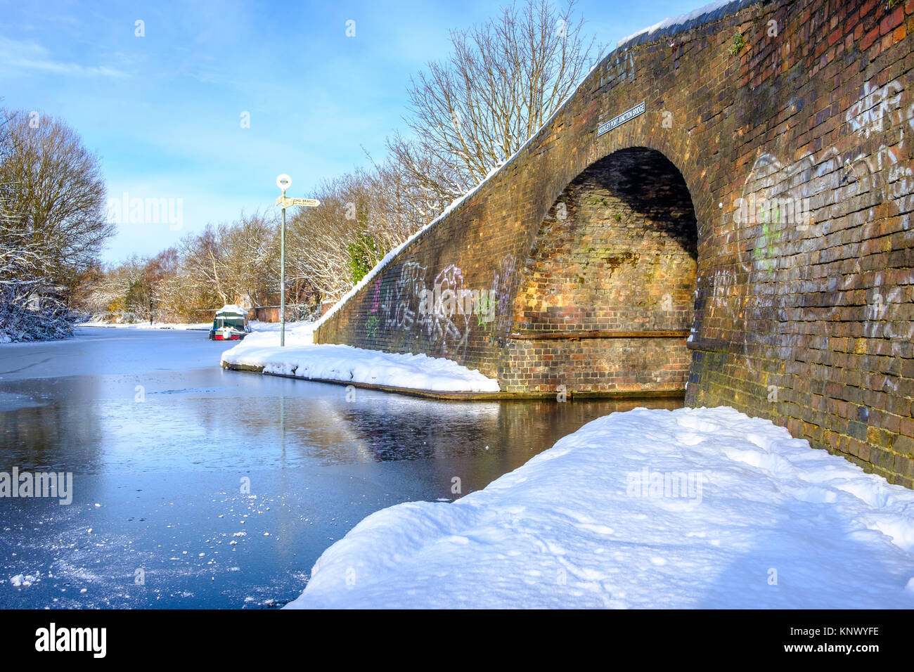 View of frozen Birmingham Canal and a bridge made of bricks Stock Photo