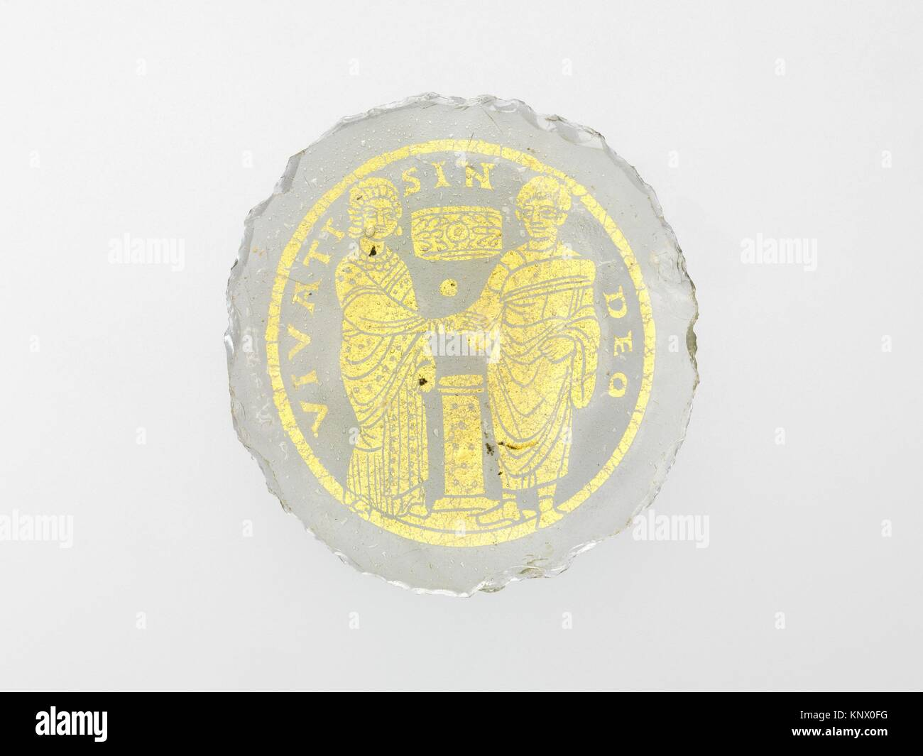 Bowl Base with a Marriage Scene. Date: 4th-5th century; Culture: Roman or Byzantine; Medium: Glass, gold leaf; Dimensions: - Stock Image