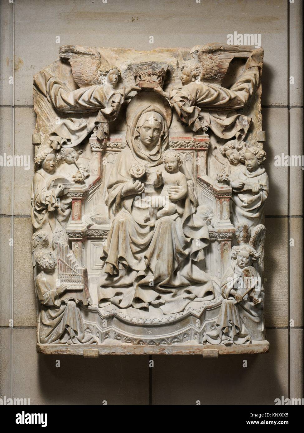 Relief with Enthroned Virgin and Child surrounded by Angels. Date: ca. 1425-40; Geography: Made in Veneto or Friuli, - Stock Image