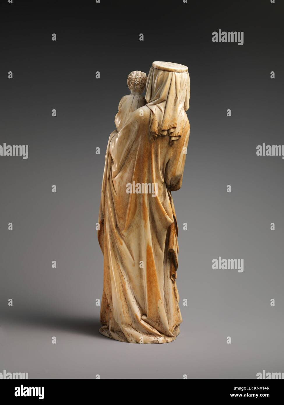 Virgin and Child. Date: ca. 1320-30; Culture: French; Medium: Ivory with traces of polychromy and gilding, (modern - Stock Image