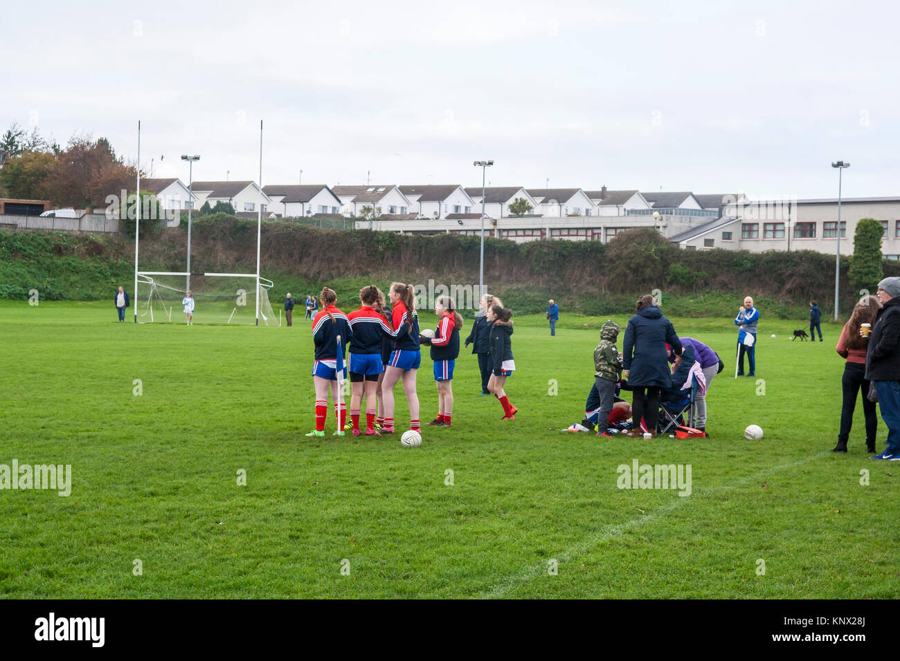 Team subs waiting to play, GAA football Match, cold winters day - Stock Image