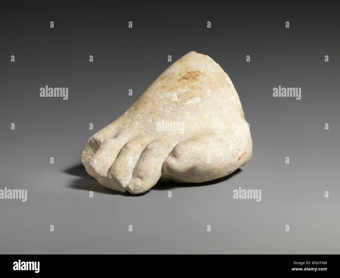 Part of the left foot of a colossal marble statue. Period: Roman; Date: 3rd-2nd century B.C; Culture: Greek; Medium: - Stock Image