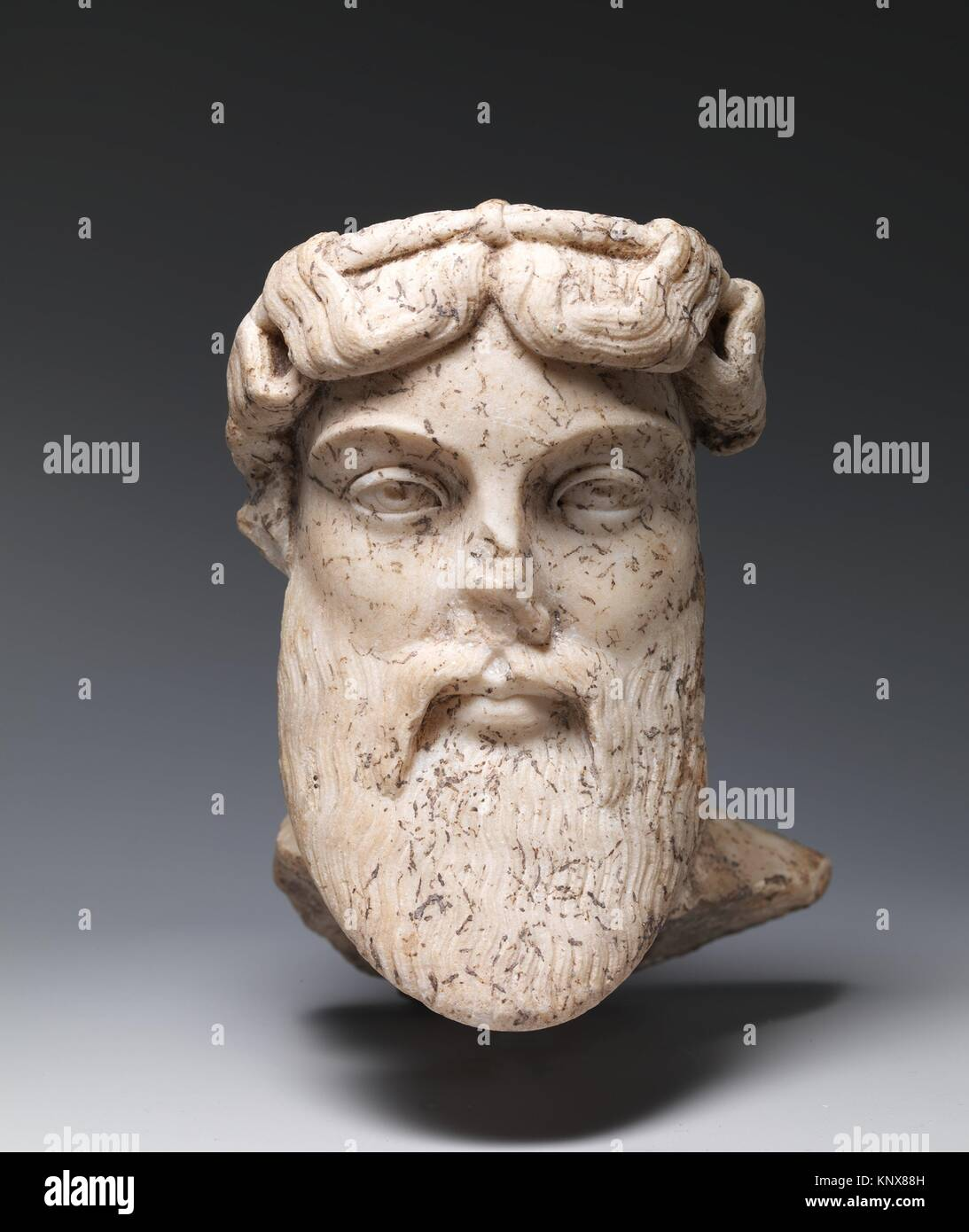 Marble head of a god, probably Dionysos. Period: Imperial; Date: 1st or 2nd century A.D; Culture: Roman; Medium: - Stock Image